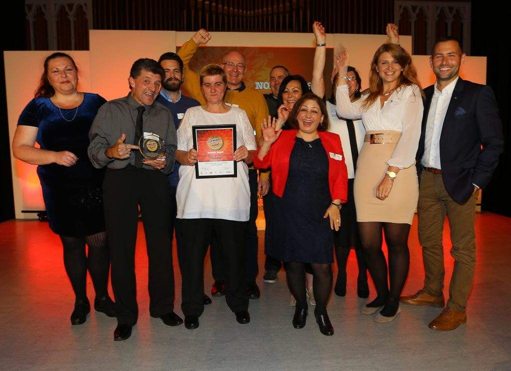 Evening Times Community Champion awards 2017 - Glasgow North West, Maryhill Community Central Hall. WINNER of the Health and Wellbeing award is North Glasgow Community food initiative. Presenting the award is Iwona Soska of the GHA, far left with host David Farrell at right. Photograph by Colin Mearns 3 October 2017